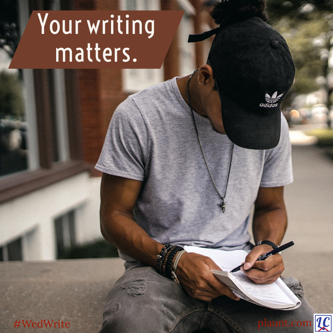 A young man sitting outside on a concrete wall writing in a notebook. A baseball cap hides his face from view as he looks down at his notes.