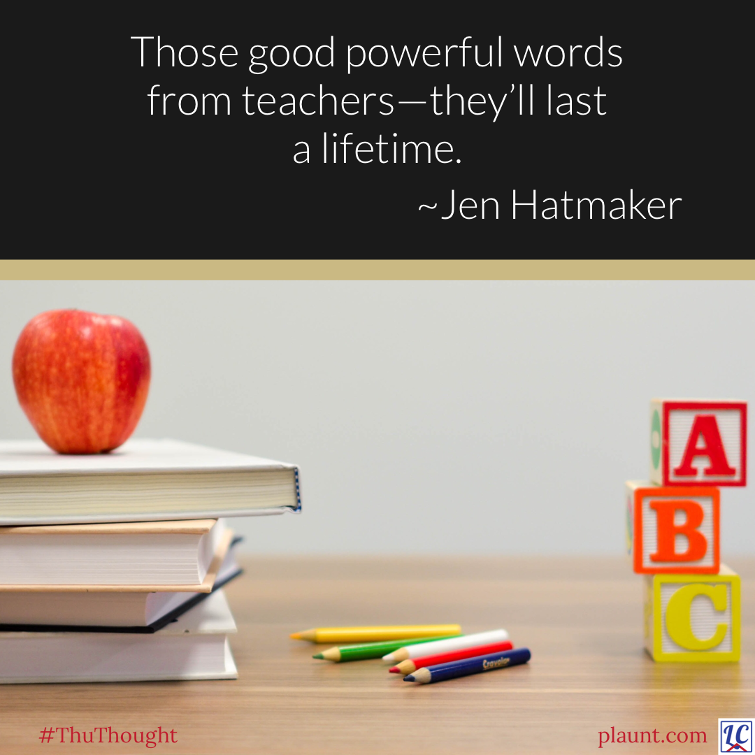 A teacher's desk with letter blocks that say A, B, C; five coloured pencils; and a stack of books, topped by an apple. In the background is a blackboard with this caption: Those good powerful words from teachers--they'll last a lifetime. ~Jen Hatmaker
