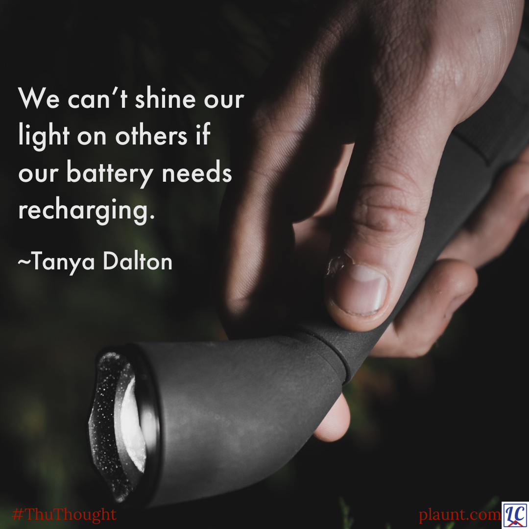 A hand holding a small flashlight. Caption: We can't shine our light on others if our battery needs recharging. ~Tanya Dalton